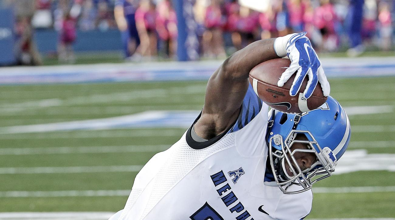 Memphis wide receiver Anthony Miller (3) is tackled by Kansas cornerback Tyrone Miller Jr. (19) during the first half of an NCAA college football game Saturday, Sept. 12, 2015, in Lawrence, Kan. (AP Photo/Charlie Riedel)