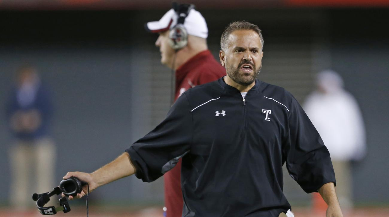 Temple coach Matt Ruhle calls for a replay of a fumble during the first half of an NCAA college football game against Cincinnati, Saturday, Sept. 12, 2015, in Cincinnati. (AP Photo/Gary Landers)