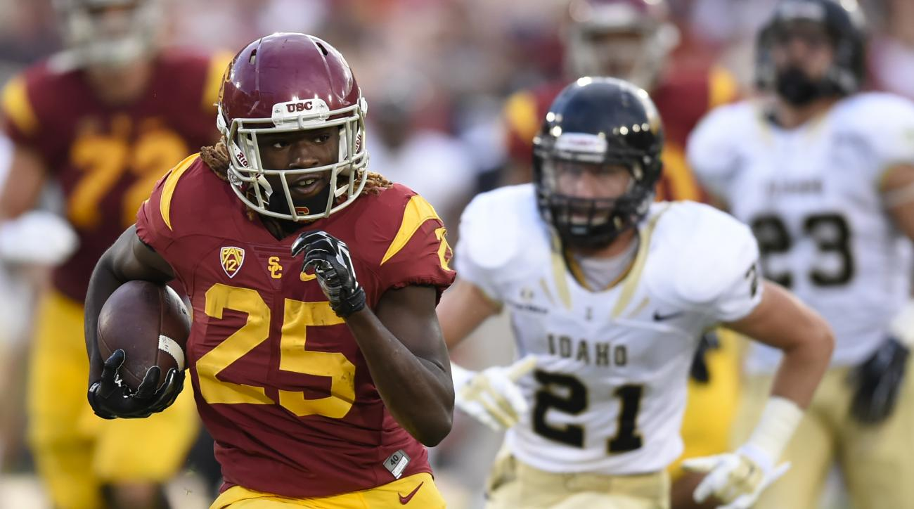 Southern California running back Ronald Jones II (25) is pursued by Idaho defensive back Jordan Grabski (21) as he rushes for a first down during the first half of an NCAA college football game, Saturday, Sept. 12, 2015, in Los Angeles. (AP Photo/Gus Ruel