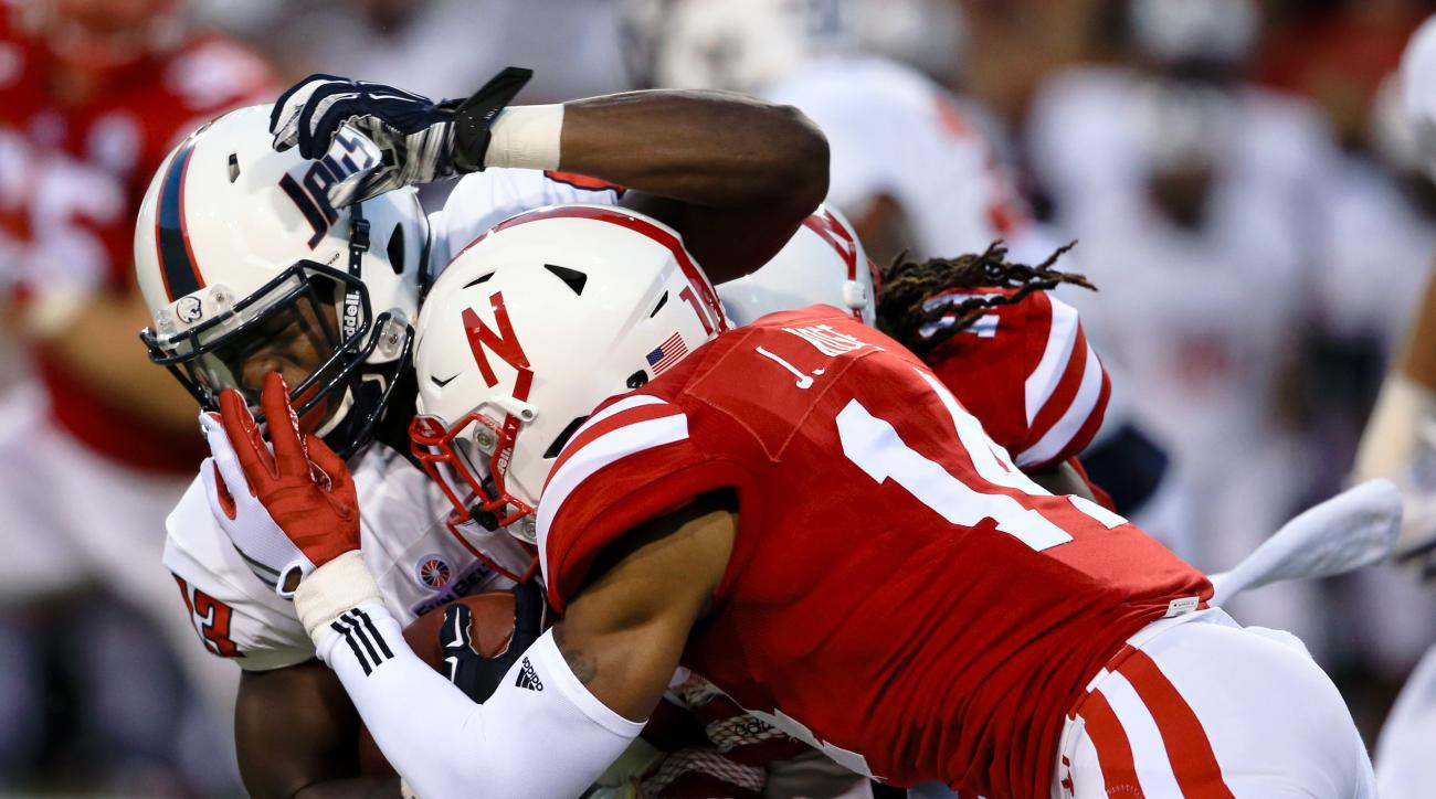 South Alabama wide receiver Claude Garrett (13) is tackled by Nebraska cornerback Jonathan Rose (14) during the first half of an NCAA college football game in Lincoln, Neb., Saturday, Sept. 12, 2015. (AP Photo/Nati Harnik)