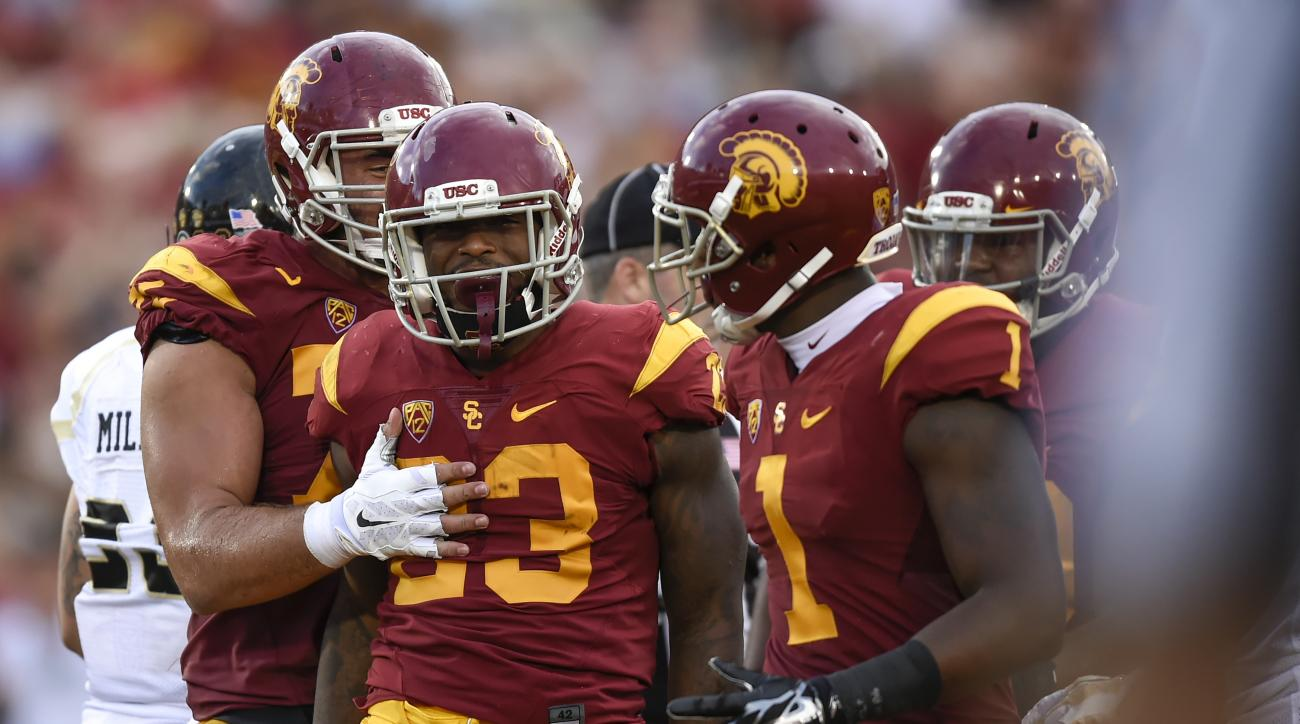 Southern California running back Tre Madden (23) celebrates with teammates, including Darreus Rogers (1), after a touchdown during the first half of an NCAA college football game against Idaho, Saturday, Sept. 12, 2015, in Los Angeles. (AP Photo/Gus Ruela