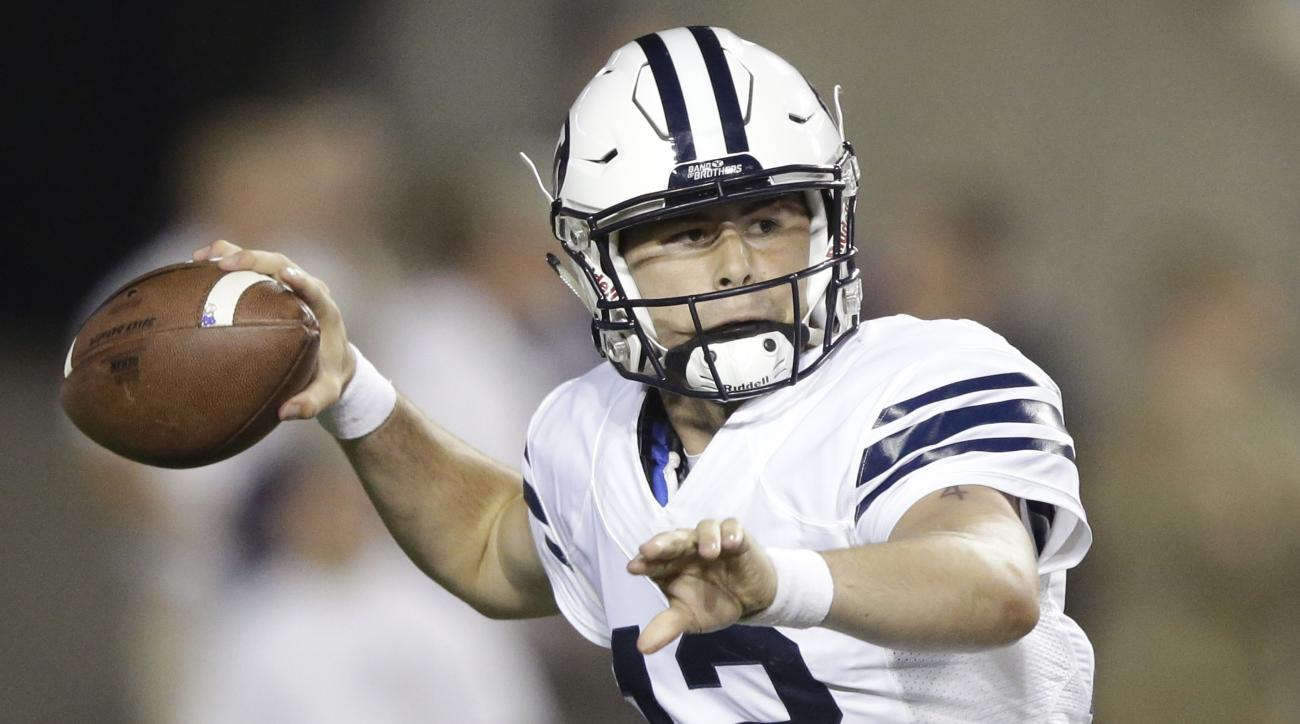 BYU quarterback Tanner Mangum (12) passes during the first half of an NCAA college football game against Boise State, Saturday, Sept. 12, 2015, in Provo, Utah. (AP Photo/Rick Bowmer)