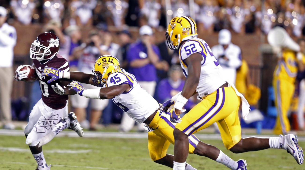 Mississippi State running back Brandon Holloway (10) carries past LSU linebacker Deion Jones (45) during the first half of an NCAA college football game in Starkville, Miss., Saturday, Sept. 12, 2015. (AP Photo/Rogelio V. Solis)