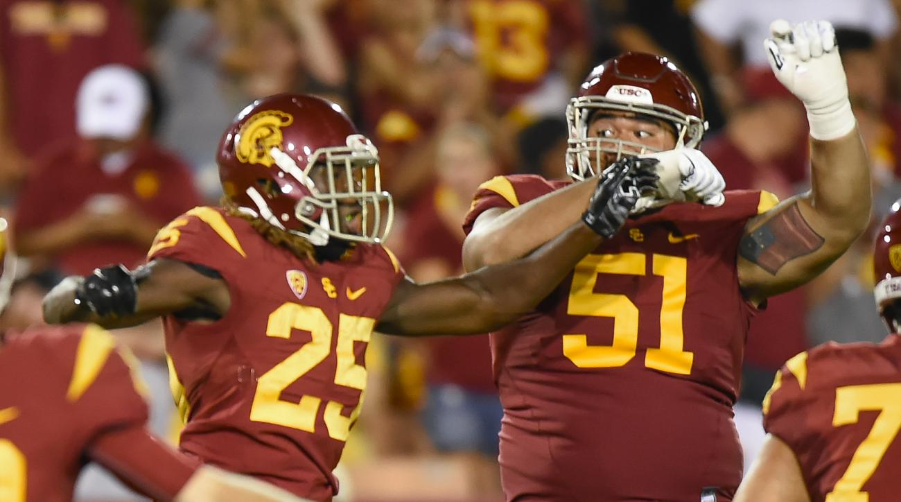 Southern California running back Ronald Jones II (25) and guard Damien Mama (51) celebrate a touchdown during the second half of an NCAA college football game against Idaho, Saturday, Sept. 12, 2015, in Los Angeles. Southern California won 59-9. (AP Photo