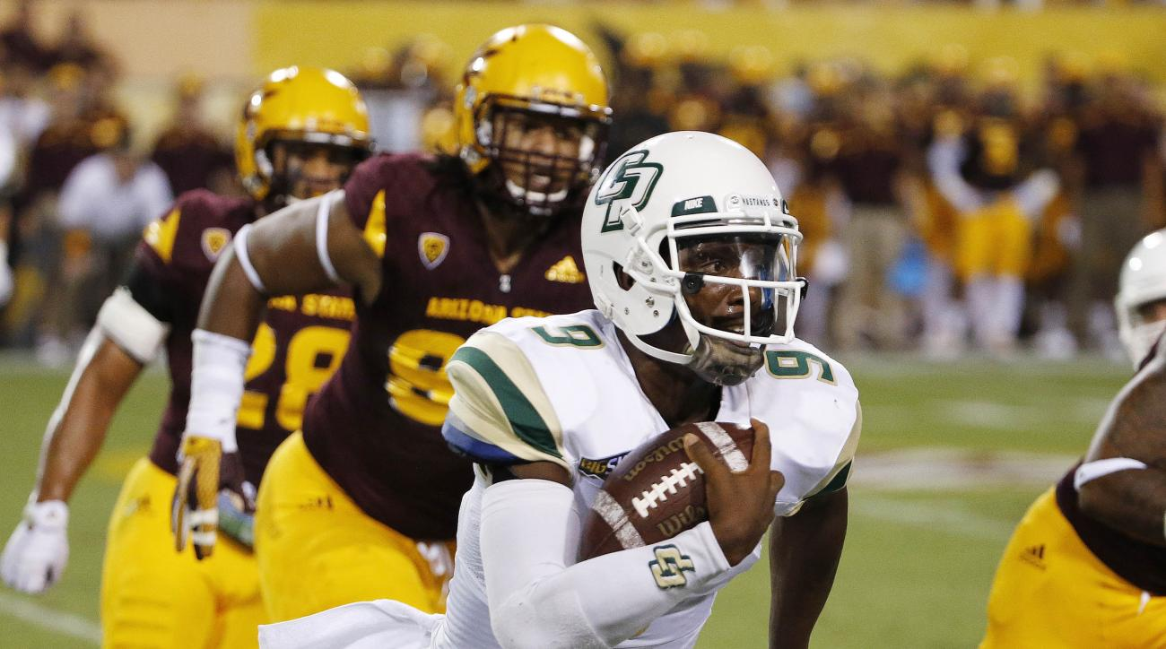 Cal Poly's Chris Brown (9) tries to get past Arizona State defenders as he runs with the ball during the first half of an NCAA college football game Saturday, Sept. 12, 2015, in Tempe, Ariz. (AP Photo/Ross D. Franklin)