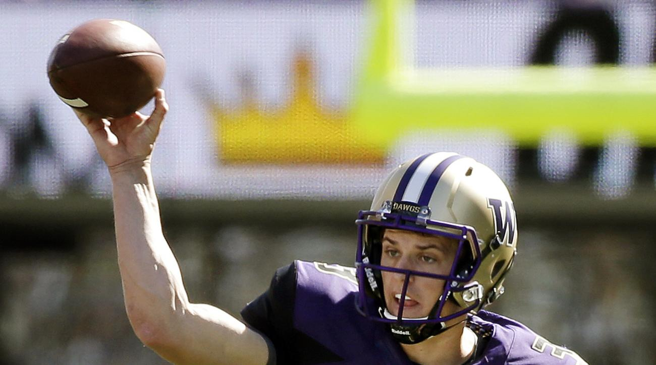 FILE - In this Sept. 12, 2015, file photo, Washington quarterback Jake Browning throws against Sacramento State in the first half of an NCAA college football game in Seattle.  It was clear freshman quarterback Jake Browning was going to have an impact for