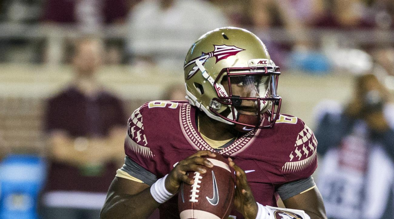 FILE - In this Sept. 5, 2015, file photo, Florida State quarterback Everett Golson rolls out to pass during the first half of an NCAA college football game against Texas State in Tallahassee, Fla. Golson has been strong in the second half of both of Flori