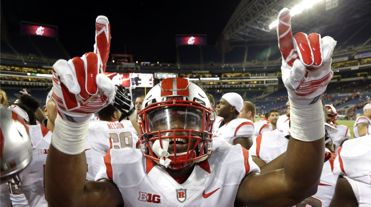 FILE - In this Aug. 28, 2014, file photo, Rutgers wide receiver Leonte Carroo (4) celebrates after they beat Washington State 41-38 in an NCAA college football game in Seattle. Carroo was suspended indefinitely by the school on Sunday, Sept. 13, 2015,  af
