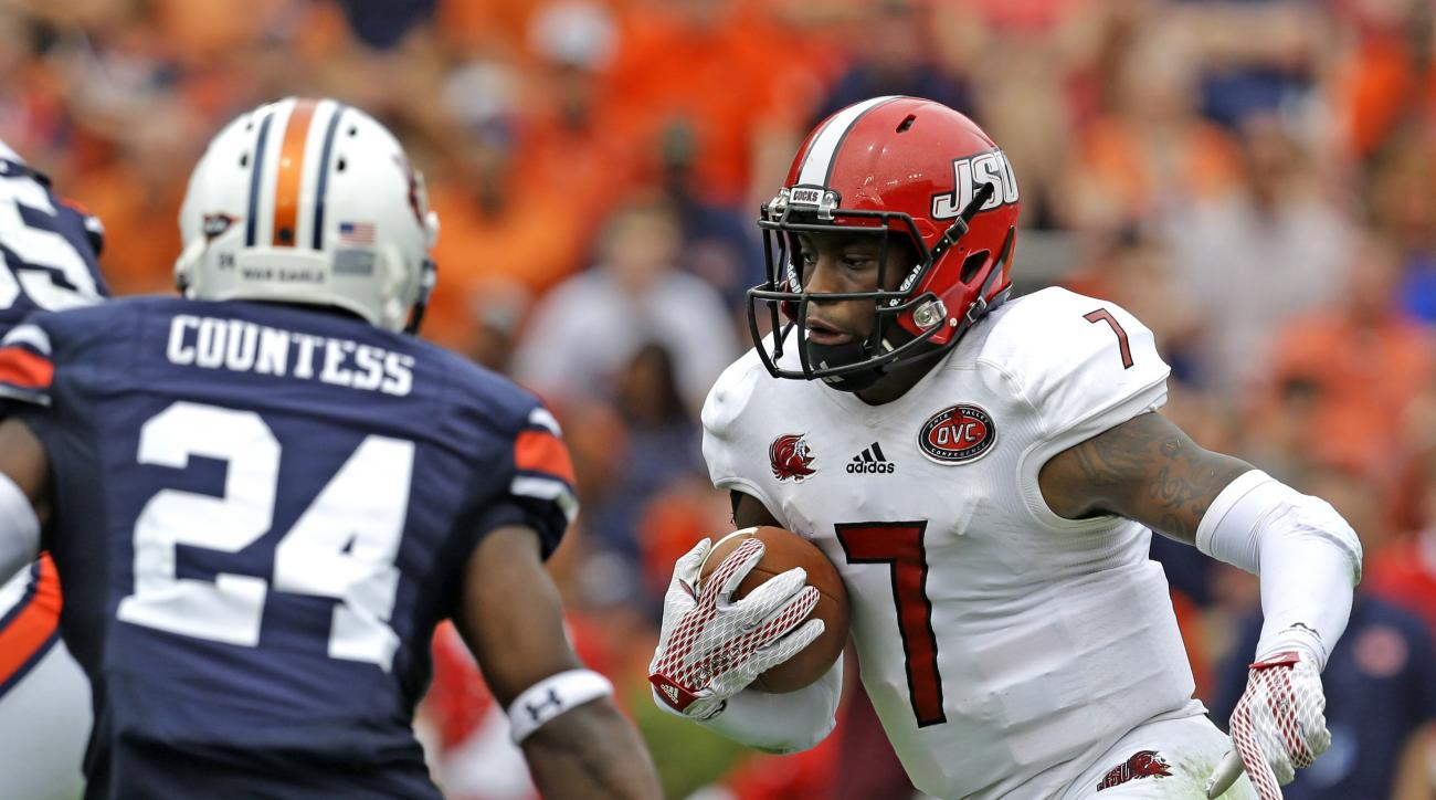 Jacksonville State quarterback Eli Jenkins (7) scrambles for a first down during the first half of an NCAA college football game against Auburn, Saturday, Sept. 12, 2015, in Auburn, Ala. (AP Photo/Butch Dill)