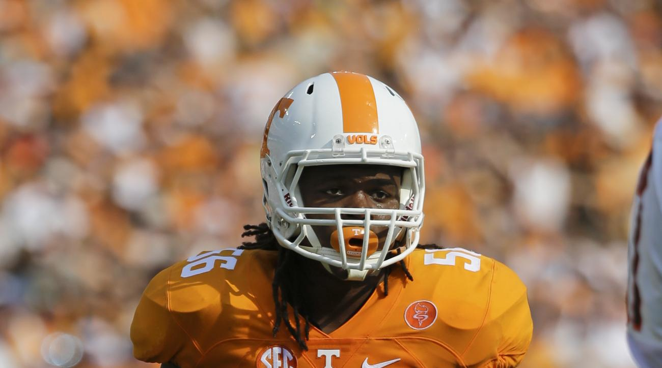 FILE - In this Sept. 5, 2015, file photo, Tennessee linebacker Curt Maggitt plays against Bowling Green in the first half of an NCAA college football game in Nashville, Tenn. Maggitt is out indefinitely after injuring his hip Saturday in a 31-24 overtime