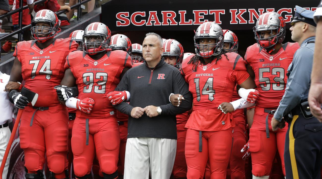 In this photo taken Saturday, Sept. 12, 2015, Rutgers head coach Kyle Flood stands with his Rutgers players before an NCAA college football game against Washington State in Piscataway, N.J. Leonte Carroo, a star Rutgers receiver, has been charged with ass