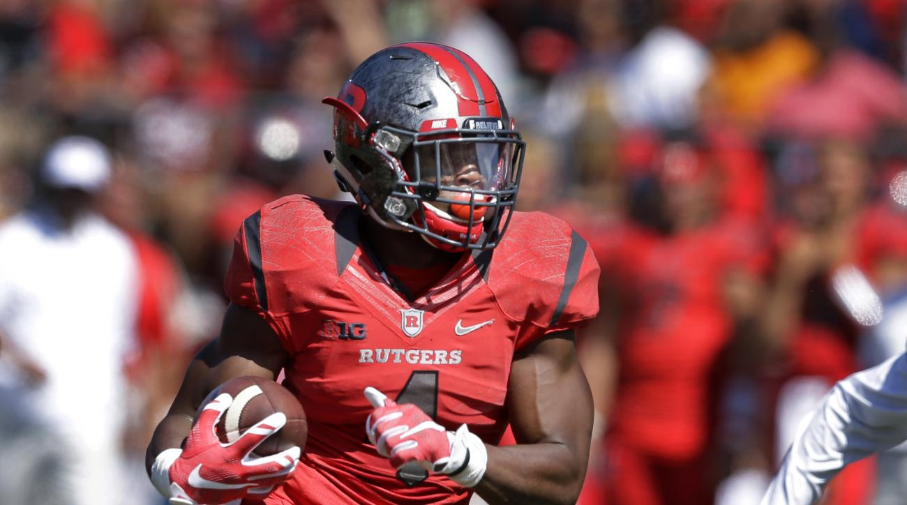 FILE - In this Saturday, Sept. 5, 2015 file photo, Rutgers wide receiver Leonte Carroo (4) runs with the ball during an NCAA college football game against Norfolk State in Piscataway, N.J. Carroo has been charged with assault in yet another arrest and sus