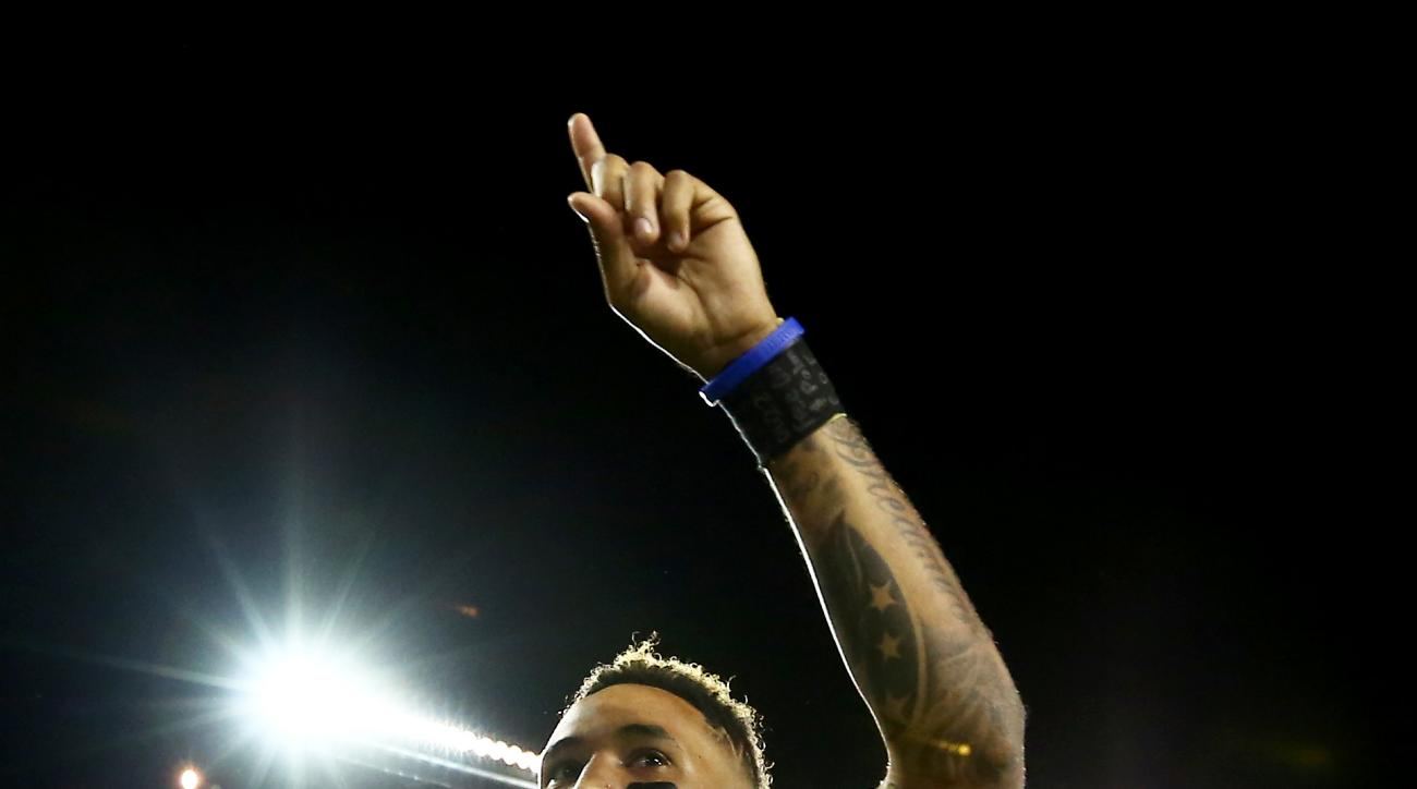 FILE - In this Sept. 5, 2015, file photo, Oregon quarterback Vernon Adams Jr. points to the crowd as he walks off the field with his hand wrapped after an NCAA college football game against Eastern Washington in Eugene, Ore.  Adams confirmed that he has a