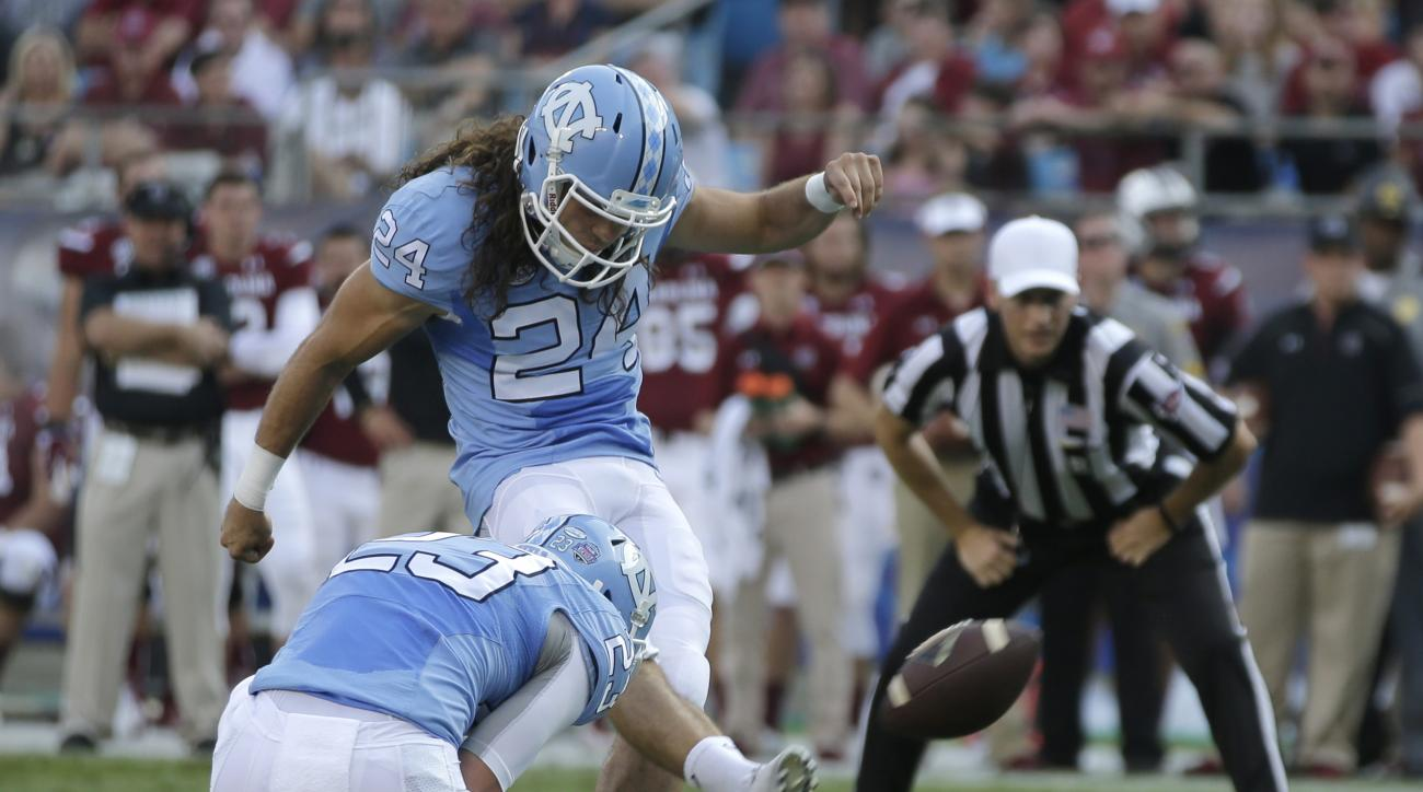 FILE - In this Sept. 3, 2015, file photo, North Carolina's Nick Weiler (24) kicks against South Carolina in the first half of an NCAA college football game in Charlotte, N.C. A year after the Tar Heels struggled to make anything beyond the shortest of kic