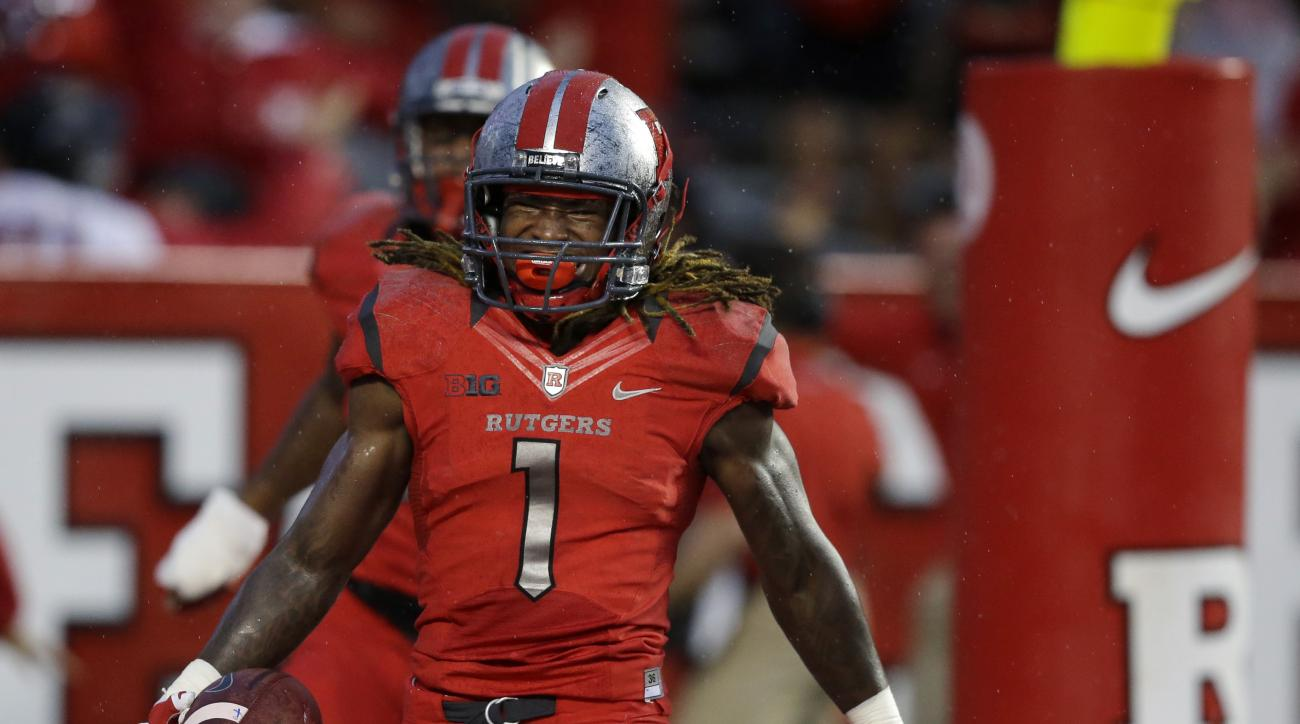 FILE - In this Saturday, Sept. 12, 2015, file phot, Rutgers wide receiver Janarion Grant (1) celebrates in the end zone during an NCAA college football game against Washington State in Piscataway, N.J. Grant scored the first time he touched the ball three