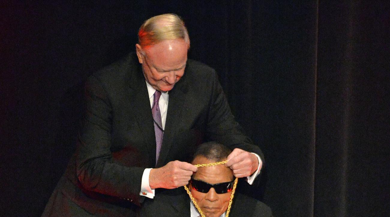 University of Louisville President Dr. James Ramsey, left, places the Grawemeyer Medal around the neck of boxing great Muhammad Ali at The Louisville Palace Theater in Louisville, Ky., Thursday, Sept. 17, 2015. Ali was awarded the inaugural Grawemeyer Spi