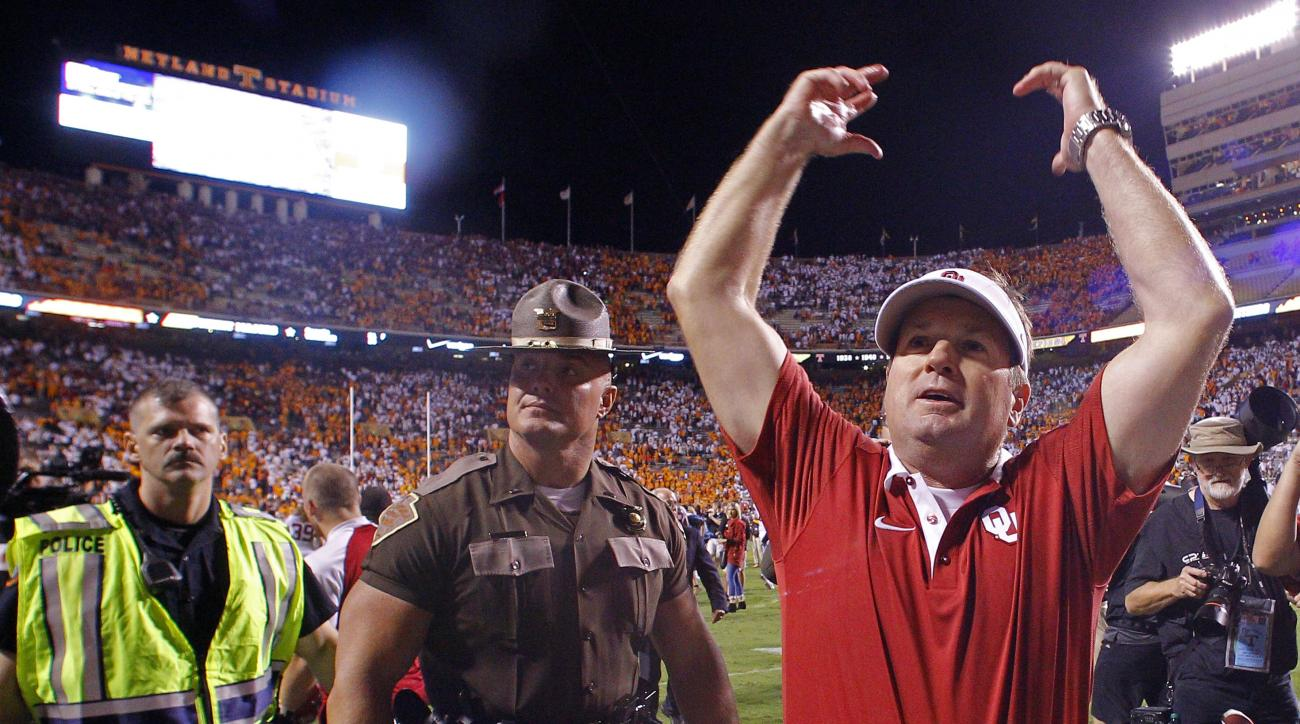 FILE - In this Saturday, Sept. 12, 2015, file photo, Oklahoma head coach Bob Stoops celebrates after defeating Tennessee 31-24 in double overtime of an NCAA college football game in Knoxville, Tenn. When players hear all week about the importance of playi
