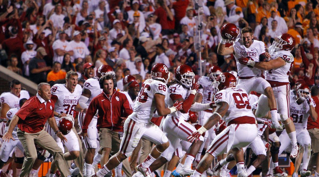 FILE - In this Saturday, Sept. 12, 2015, file photo, Oklahoma players celebrate a 31-24 double overtime victory in an NCAA college football game against Tennessee in Knoxville, Tenn. When players hear all week about the importance of playing with passion,