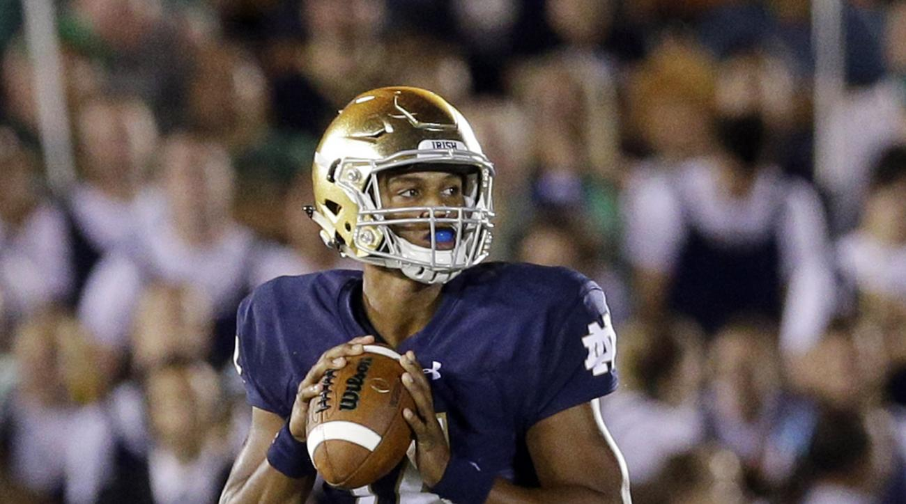 In this photo taken Saturday, Sept. 5, 2015, Notre Dame quarterback DeShone  Kizer (14) looks to a pass during the second half of an NCAA college football game against Texas in South Bend, Ind. The No. 8 Irish are slight underdogs at home against No. 14 G