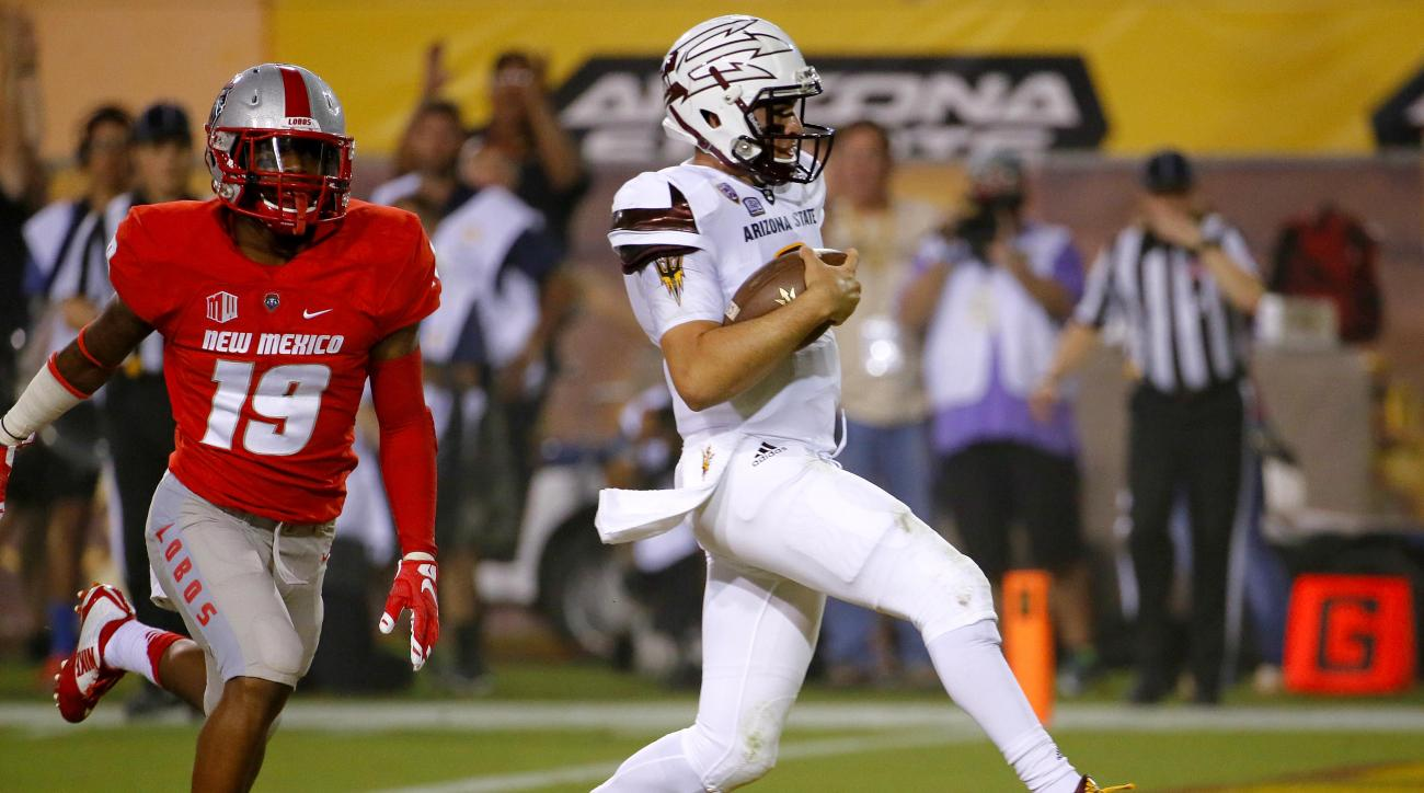 Arizona State quarterback Mike Bercovici (2) scores a touchdown as New Mexico cornerback Nias Martin (19) defends during the second half of an NCAA college football game, Friday, Sept. 18, 2015, in Tempe, Ariz. (AP Photo/Matt York)