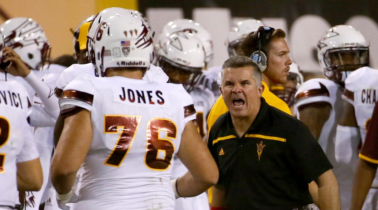 Arizona State head coach Todd Graham yells at lineman Sam Jones (76) during the second half of an NCAA college football game against New Mexico, Friday, Sept. 18, 2015, in Tempe, Ariz. (AP Photo/Matt York)