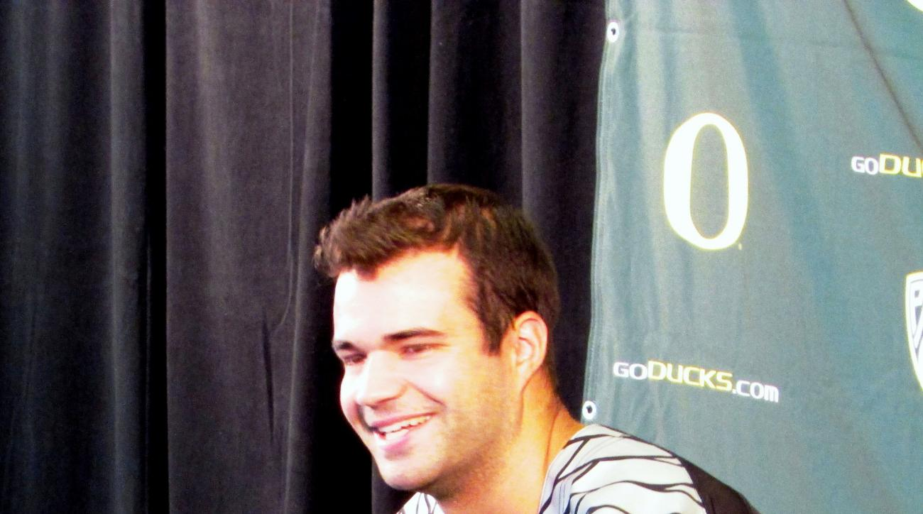 Oregon quarterback Jeff Lockie, who was backup to Heisman Trophy winner Marcus Mariota last season, addresses the media at the Ducks' first day of fall camp in Eugene, Oregon, on Aug. 10, 2015. (AP Photo/Anne M. Peterson).