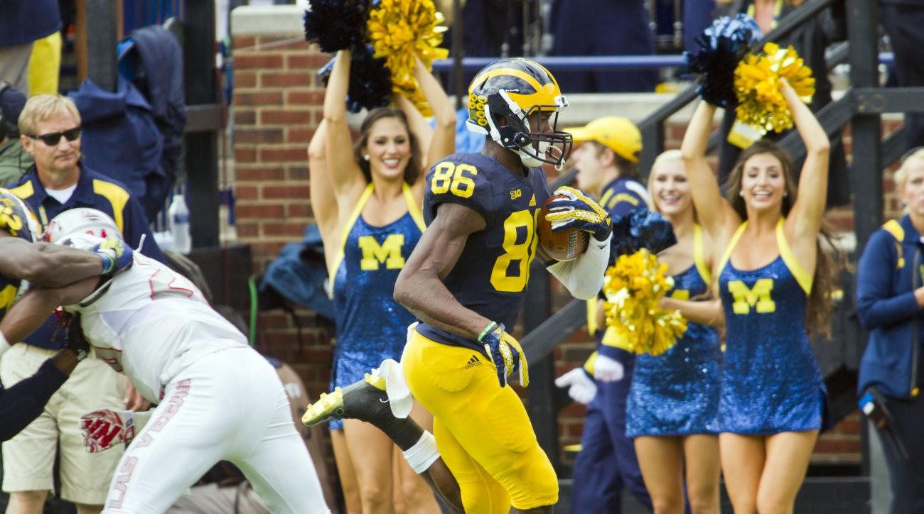 Michigan wide receiver Jehu Chesson (86) rushes for a touchdown in the second quarter of an NCAA college football game against UNLV in Ann Arbor, Mich., Saturday, Sept. 19, 2015. (AP Photo/Tony Ding)