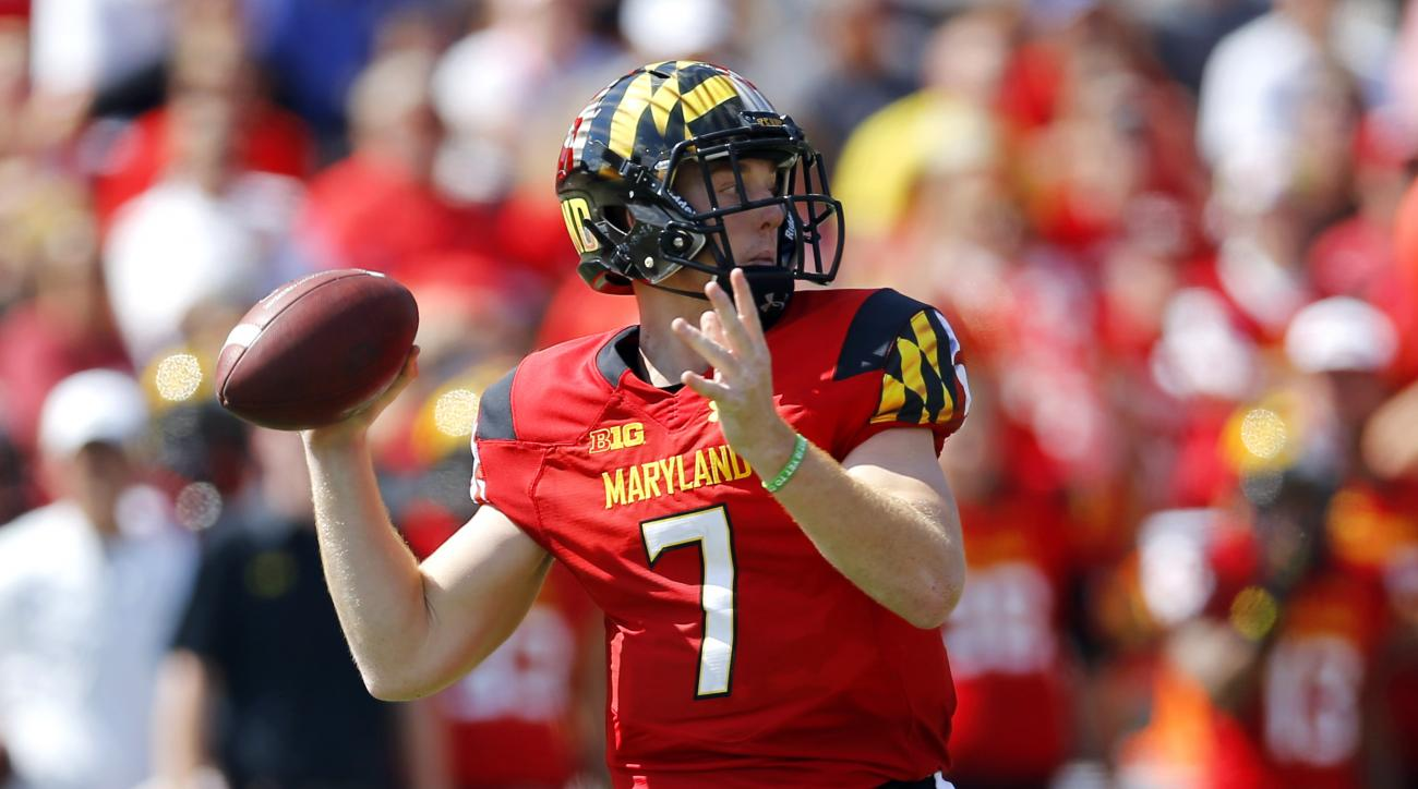 Maryland quarterback Caleb Rowe throws to a receiver in the first half of an NCAA college football game against South Florida, Saturday, Sept. 19, 2015, in College Park, Md. (AP Photo/Patrick Semansky)