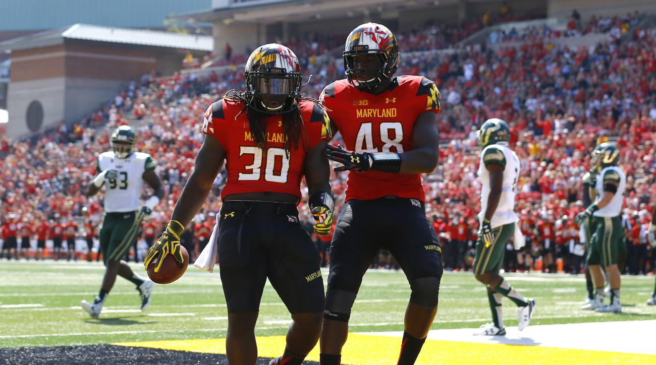 Maryland running back Kenneth Goins Jr., left, celebrates his touchdown with teammate Derrick Hayward in the first half of an NCAA college football game, Saturday, Sept. 19, 2015, in College Park, Md. (AP Photo/Patrick Semansky)
