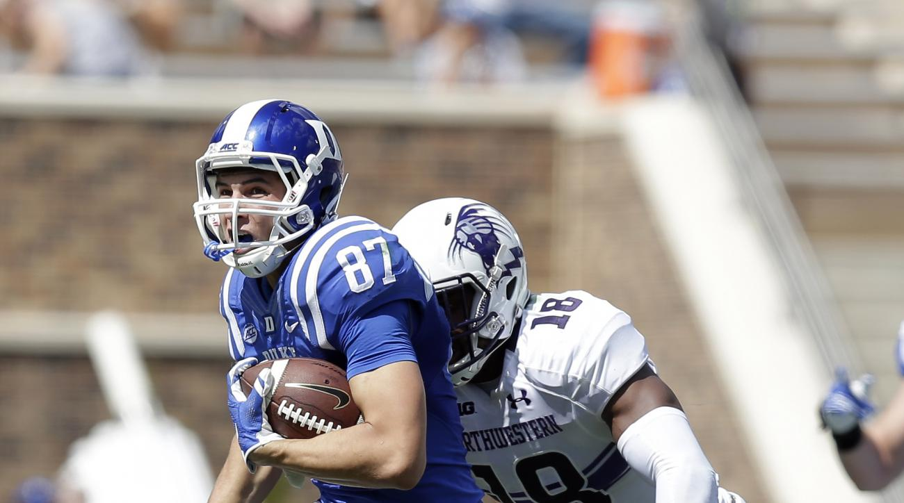 Duke's Max McCaffrey (87) runs the ball as Northwestern's Anthony Walker (18) chases during the first half of an NCAA college football game in Durham, N.C., Saturday, Sept. 19, 2015. (AP Photo/Gerry Broome)