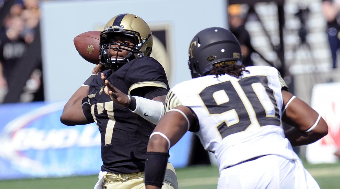 Army quarterback Ahmad Bradshaw (17) throws a pass as Wake Forest defensive lineman Rashawn Shaw (90) approaches during an NCAA college football game on Saturday, Sept. 19, 2015, in West Point, N.Y. (AP Photo/Hans Pennink)