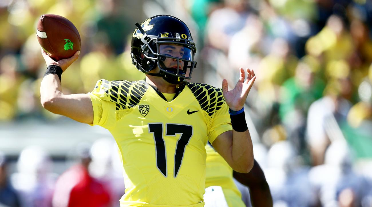Oregon quarterback Jeff Lockie (17) throws the football during the first quarter of an NCAA college football game against Georgia State, Saturday, Sept. 19, 2015, in Eugene, Ore. (AP Photo/Ryan Kang)