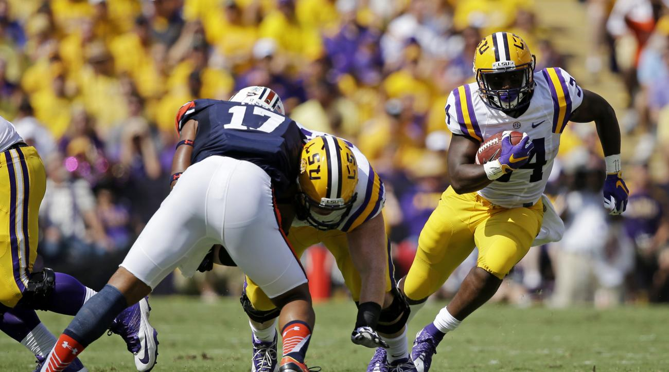 LSU running back Darrel Williams (34) carries past Auburn linebacker Kris Frost (17) in the first half of an NCAA college football game in Baton Rouge, La., Saturday, Sept. 19, 2015. (AP Photo/Gerald Herbert)