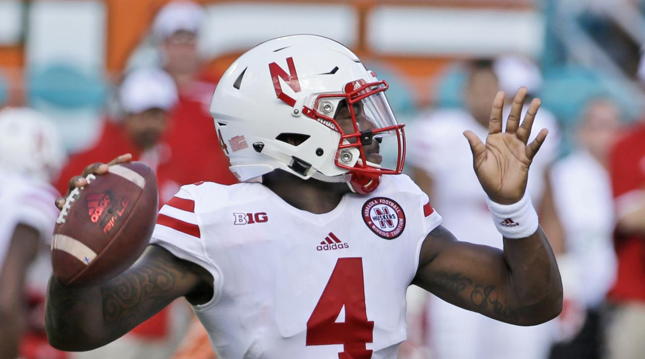 Nebraska quarterback Tommy Armstrong Jr. passes during the first half of an NCAA college football game against Miami, Saturday, Sept. 19, 2015 in Miami Gardens, Fla. (AP Photo/Wilfredo Lee)
