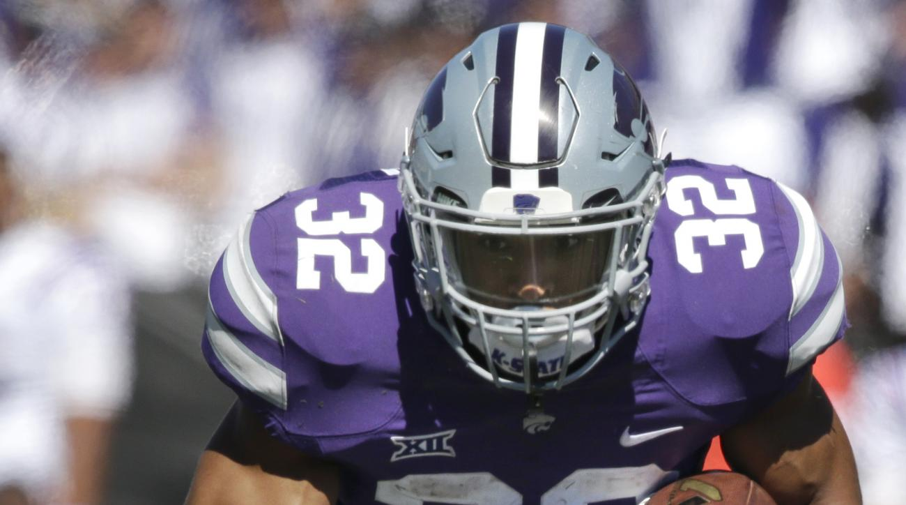 Kansas State running back Dalvin Warmack (3) is tackled by Louisiana Tech linebacker Beau Fitte (6) during the first half of an NCAA college football game in Manhattan, Kan., Saturday, Sept. 19, 2015. (AP Photo/Orlin Wagner)