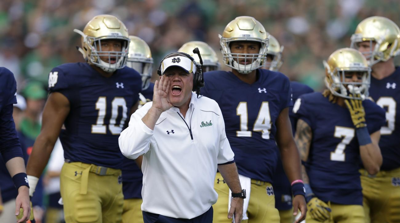 Notre Dame head coach Brian Kelly yells from the sideline during the first half of an NCAA college football game against the Georgia Tech in South Bend, Ind., Saturday, Sept. 19, 2015. (AP Photo/Michael Conroy)
