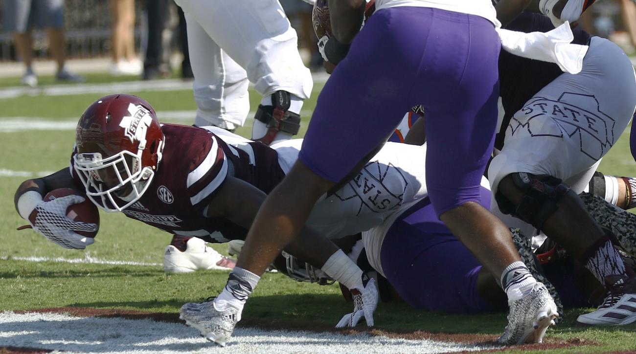 Mississippi State running back Aeris Williams (27) scores a touchdown on a short dive into the end zone past Northwestern State defenders during the first half of an NCAA college football game, Saturday, Sept. 19, 2015 in Starkville, Miss. (AP Photo/Rogel