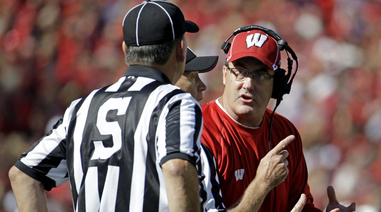 Wisconsin head coach Paul Chryst, right, argues a call during the first half of an NCAA college football game against Troy Saturday, Sept. 19, 2015, in Madison, Wis. (AP Photo/Morry Gash)