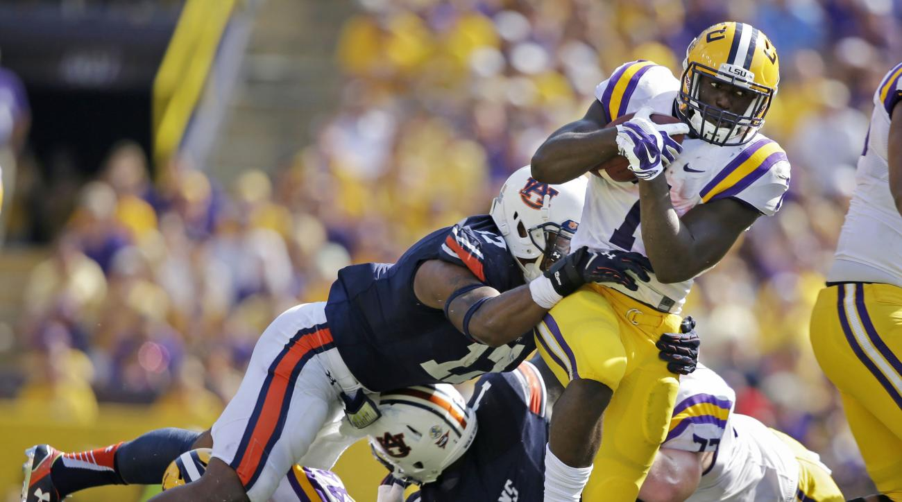 Auburn linebacker Kris Frost (17) tries to tackle LSU running back Leonard Fournette (7) in the first half of an NCAA college football game in Baton Rouge, La., Saturday, Sept. 19, 2015. (AP Photo/Gerald Herbert)