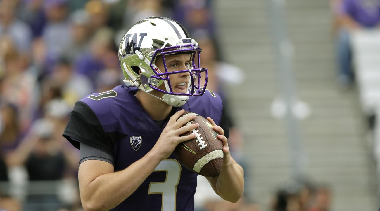 Washington quarterback Jake Browning drops to pass against Utah State in the first half of an NCAA college football game, Saturday, Sept. 19, 2015, in Seattle. (AP Photo/Ted S. Warren)