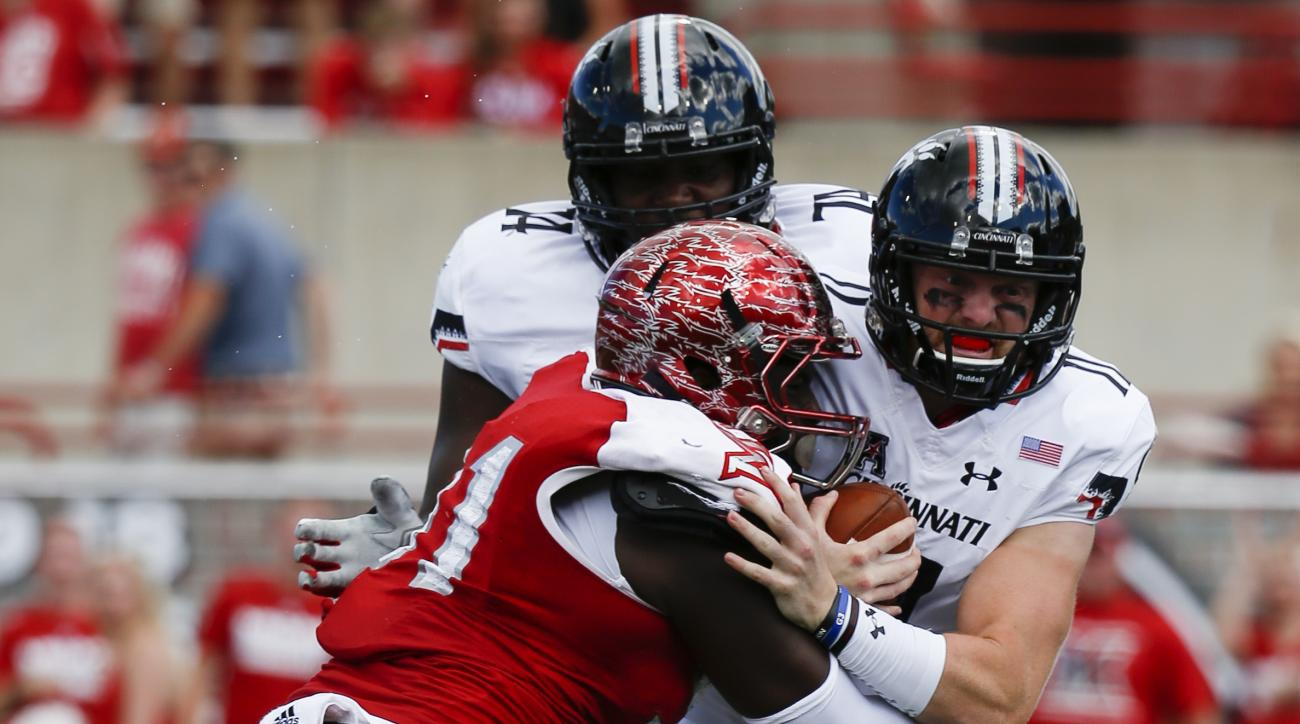 Cincinnati quarterback Gunner Kiel, right, is sacked by Miami of Ohio defensive lineman Austin Gearing, left, in the first half of an NCAA college football game at Yager Stadium, Saturday, Sept. 19, 2015, in Oxford, Ohio. (AP Photo/John Minchillo)