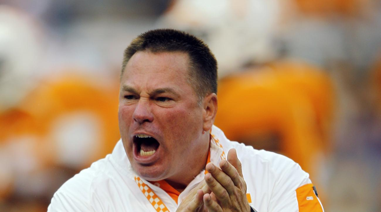Tennessee head coach Butch Jones yells to his players during warmups before an NCAA college football game against Western Carolina, Saturday, Sept. 19, 2015, in Knoxville, Tenn. (AP Photo/Wade Payne)