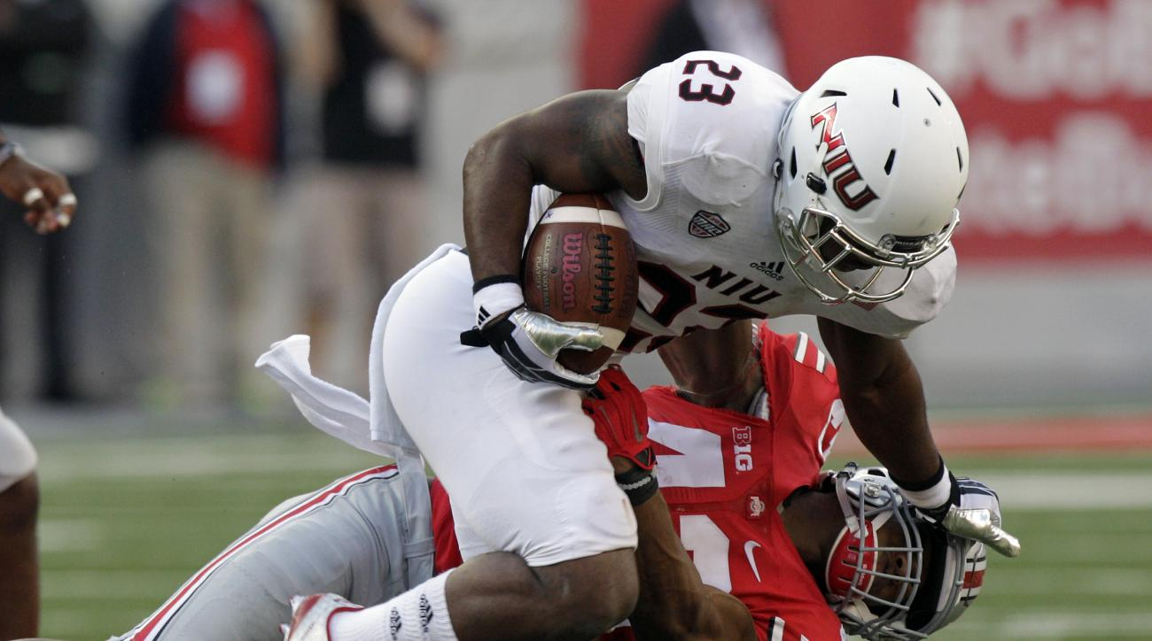 Northern Illinois tailback Jordan Huff, top, stiff-arms Ohio State linebacker Darron Lee during the fourth quarter of an NCAA college football game Saturday, Sept. 19, 2015, in Columbus, Ohio. Ohio State won 20-13. (AP Photo/Jay LaPrete)
