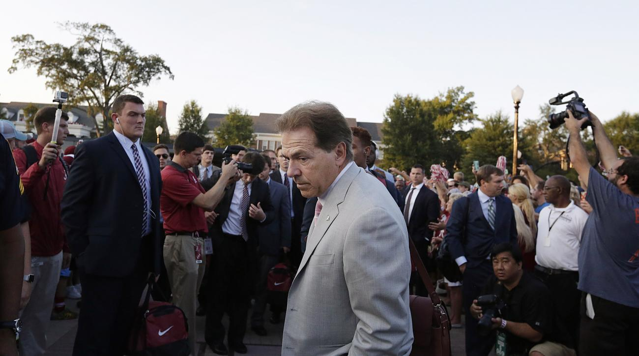 Alabama coach Nick Saban walks through the crowd of fans before the team's NCAA college football game against Mississippi, Saturday, Sept. 19, 2015, in Tuscaloosa, Ala. (AP Photo/Brynn Anderson)