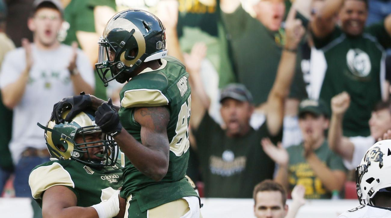 Colorado State  wide receivers Xavier Williams, left, celebrates with Rashard Higgins after his touchdown catch against Colorado in the first quarter of an NCAA college football game Saturday, Sept. 19, 2015, in Denver. (AP Photo/David Zalubowski)