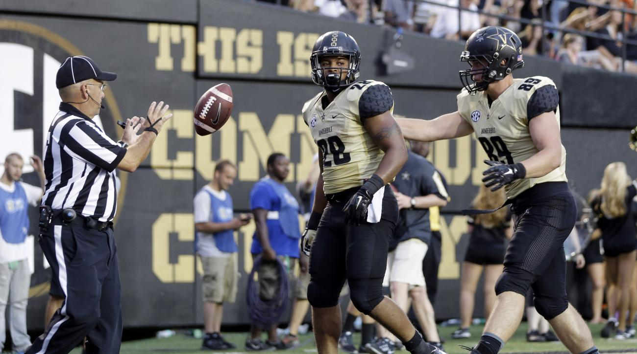 Vanderbilt running back Dallas Rivers (28) is congratulated by tight end Sean Dowling (89) after Rivers scored a touchdown against Austin Peay on a 4-yard run in the second half of an NCAA college football game, Saturday, Sept. 19, 2015, in Nashville, Ten