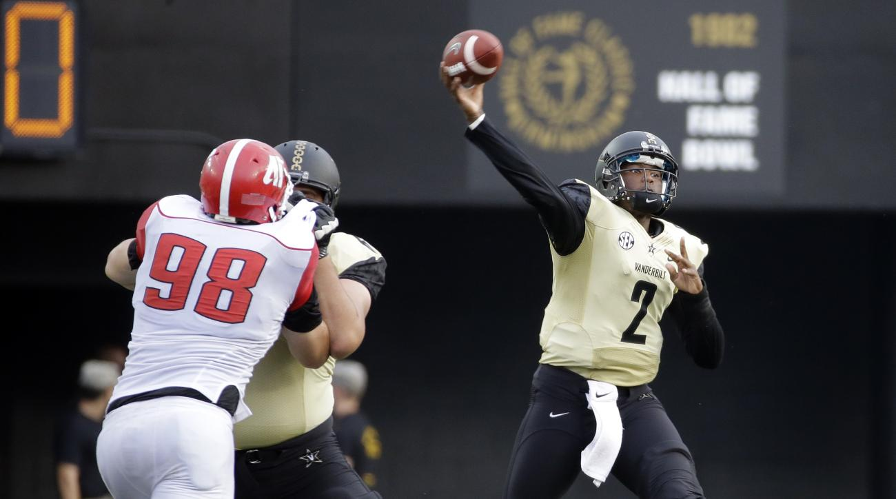 Vanderbilt quarterback Johnny McCrary (2) passes as Austin Peay defensive tackle Branden Johnson (98) rushes in the second half of an NCAA college football game, Saturday, Sept. 19, 2015, in Nashville, Tenn. Vanderbilt won 47-7. (AP Photo/Mark Humphrey)