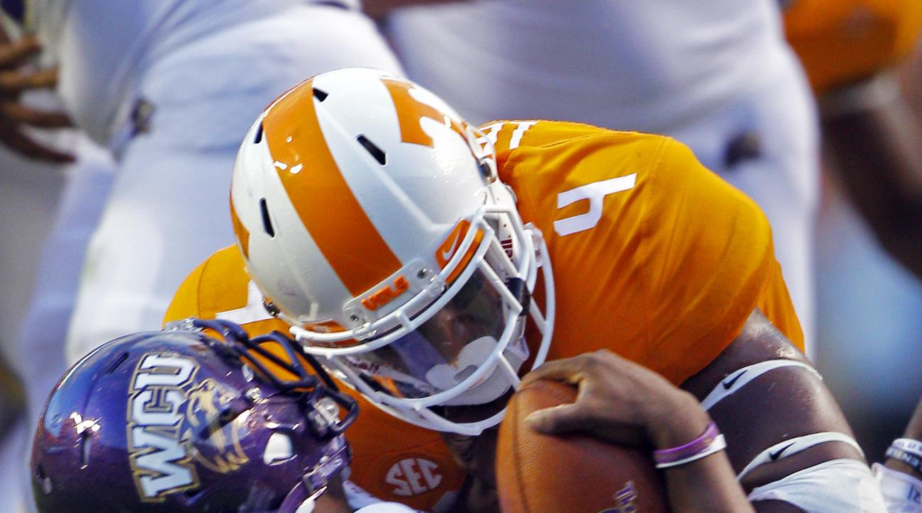 Western Carolina quarterback Troy Mitchell (10) is tackled by Tennessee defensive lineman LaTroy Lewis (4) during the first half of an NCAA college football game Saturday, Sept. 19, 2015, in Knoxville, Tenn. (AP Photo/Wade Payne)