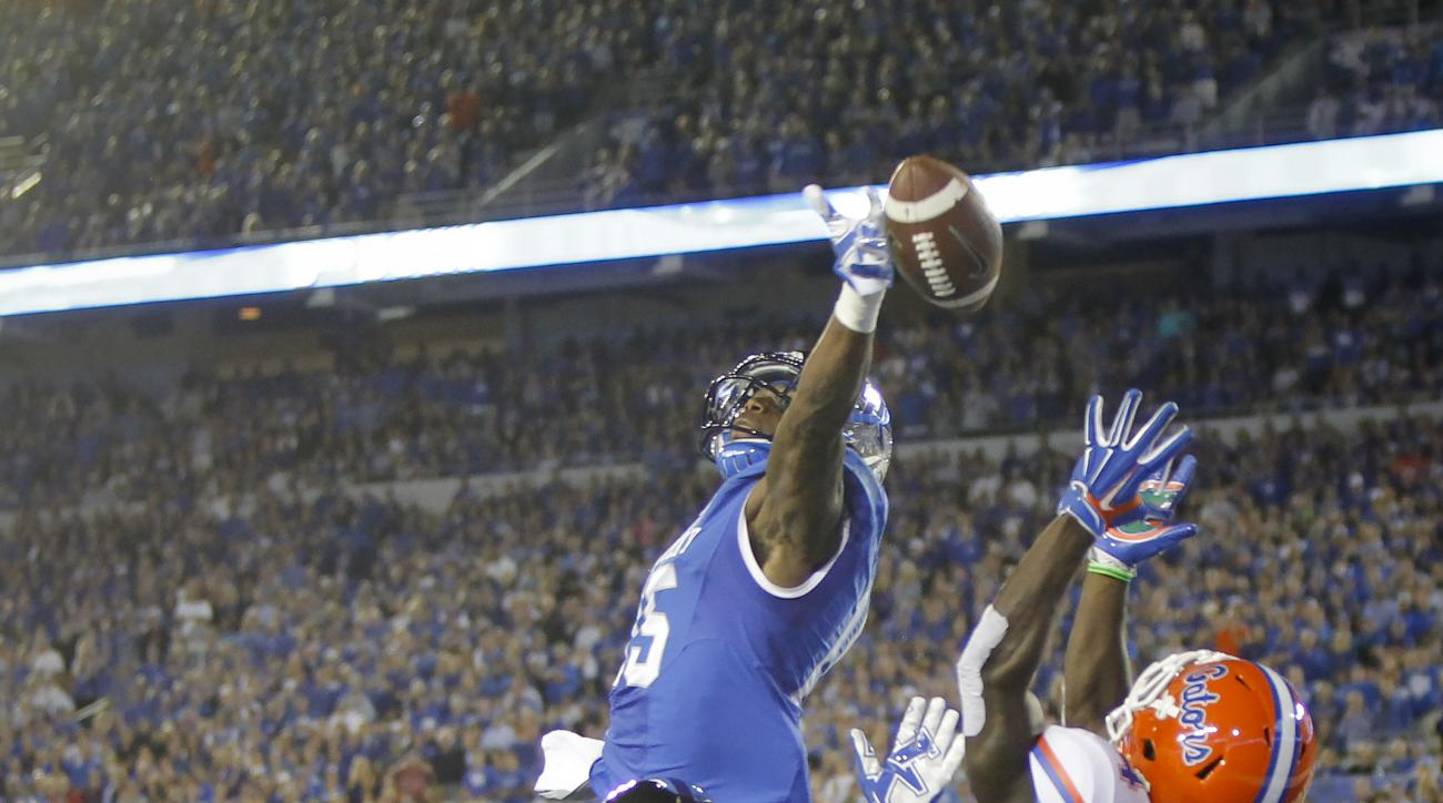 Kentucky safety Marcus McWilson, top, deflects a pass intended for Florida wide receiver Brandon Powell (4) as Kentucky cornerback Kendall Randolph helps defend in the end zone during the first half of an NCAA college football game, Saturday, Sept. 19, 20