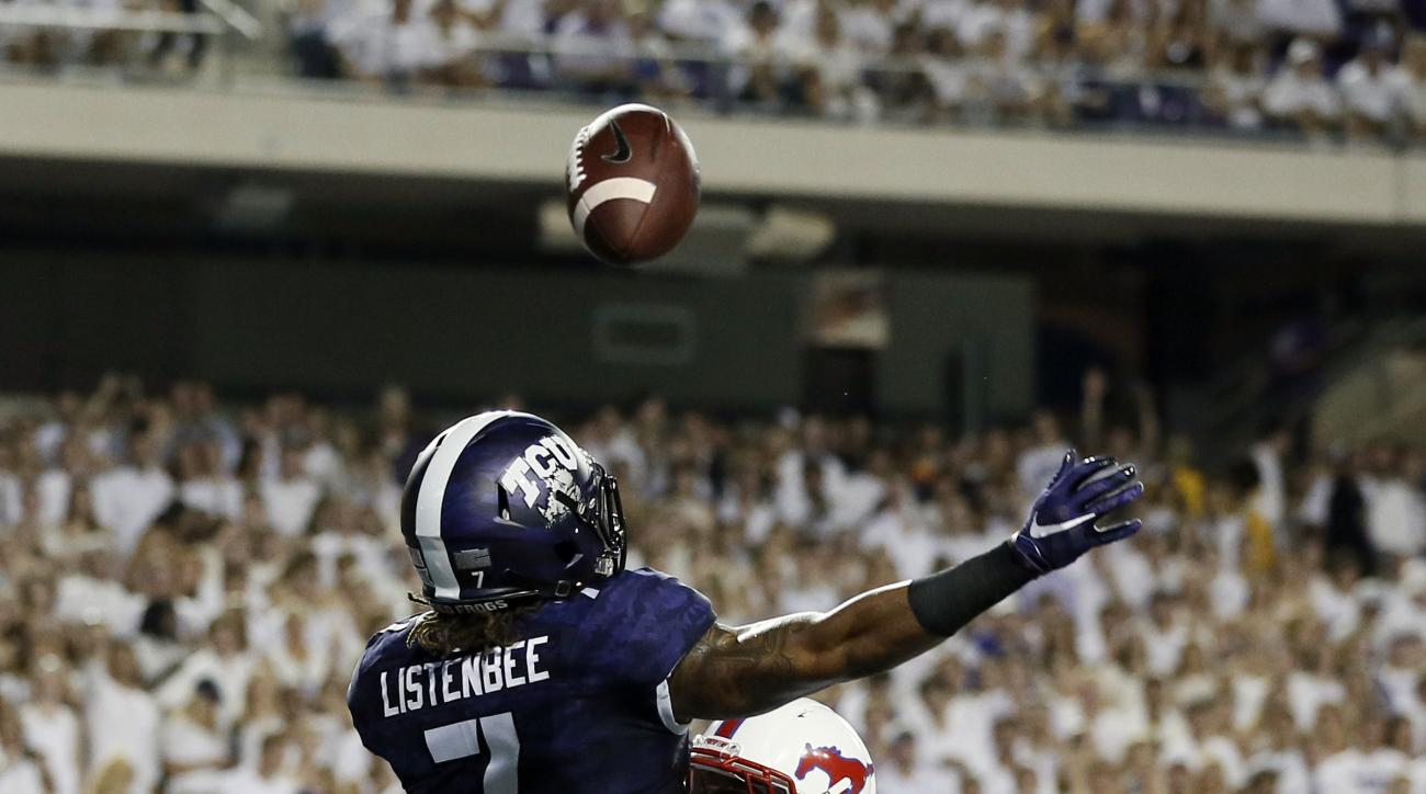 TCU wide receiver Kolby Listenbee (7) is unable to grab a pass in the end zone against SMU defensive back David Johnson (4) in the first half of an NCAA college football game Saturday, Sept. 19, 2015, in Fort Worth, Texas. (AP Photo/Tony Gutierrez)